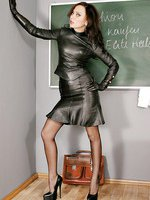 Sexy teacher Nadja dressed in leather, stockings and high heel shoes