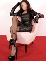 Nadja dressed in leather catsuit, stockings and high heel shoes