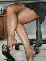 Pantyhosed Rita Faltoyano in Office Setting