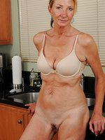 Horny old 56 year old Pam  spreads her mature pussy in the kitchen