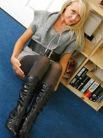 Beautiful blonde Lucy-Anne shows off her lovely legs in a thick grey minidress with dark stockings and suspenders.