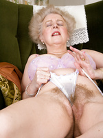 Older gray haired lady spreading her very hairy bush