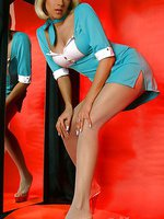 Sexy stewardess Lily spreads sexy legs in pantyhose