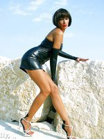 Long sexy MILF legs in seamed pantyhose and high heels