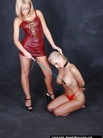 Gorgeous topless blonde is bound and gagged then spanked by hot lesbian slut