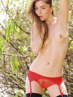 Stunning Anastasia in red panty and black stockings horny under the sun.
