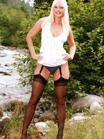 Blonde posing in her stockings and suspender.