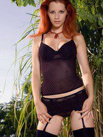 Ariel posing in her black stockings and sheer top.