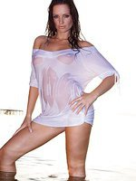 Lovely brunette Sandra Shine posing in wet shirt in the water