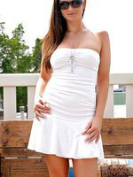 Sandra Shine masturbates on a sun roof in sexy white dress
