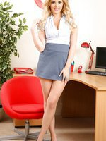 Short skirt and tan stockings are flashed in this wonderful secretary set from Porchia