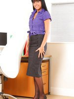 Lovely Laetitia in knee length skirt and black pantyhose