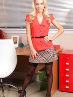 Cute blonde in a tartan miniskirt and red blouse.