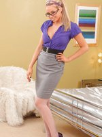 This stunning blonde could be the envy of any office in her tight purple blouse, tight pencil skirt and white pantyhose.