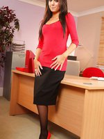 Jamie A in a black pencil skirt and tight red top with matching heels.