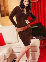 Anastasia looks incredible in her tfigure hugging brown dress and heels.