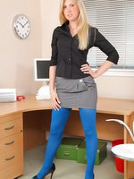 Stunning, leggy blonde loves to tease her work colleagues by posing in her office.