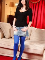 Georgina D in a tiny denim miniskirt and tight black top with bright blue stockings.