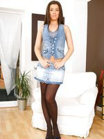 Glorious Brunette Natalia strips from her denim mini skirt with matching denim top
