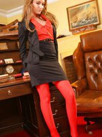 Faye shows off her seductive side as she strips out of her skirt suit and red stockings.
