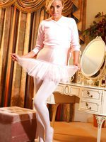 Cute blonde ballerina in a pink leotard and tutu.