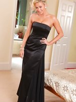 Leah F looks amazing in her floor length black evening dress and black stockings.