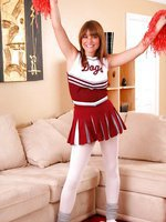 Amy P looks perfect posing in her cheerleader uniform on her sofa.