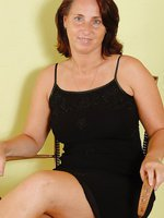 45 year old housewife Demi from AllOver30 spreads wide on her chair