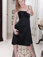 Petite 30 year old Beyla slips out of her elegant dress and spreads