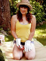 Redheaded 33 year old Ava gets tired of gardening so strips instead