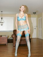 Desirae in Hot Blue and green lingerie with garters and sheer stockings