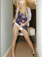 Blonde darling has stockings over her legs