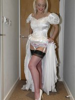 Blonde in white wedding dress with stockings