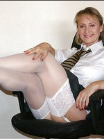 Aged beauty loves being naughty at work