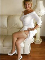 Curvy babe stuns in white