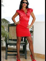 Seductress wears a shiny red dress