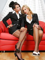 Two business ladies in pantyhose make out