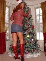 Slut is wearing stunning red long boots