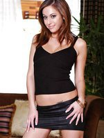 Cassia shows-off her body with a tight shirt and a short skirt.