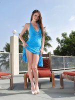 Slut in a blue dress by the pool