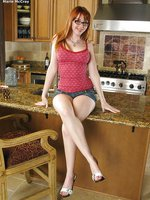 Redhead gets messy in the kitchen