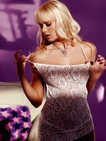 is an elegant nude blonde in a purple room