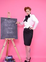 Strict teacher Elle Richie in black stocking stripteases to get a students attention.
