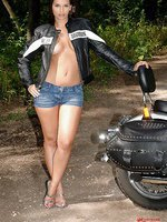 Hot Eve Angel posing with motorbike
