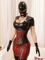 Latex beauty enjoys a rubber cock