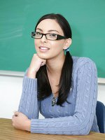 Perfect brunette nerd in glasses takes a facial after school