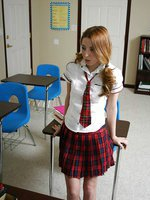 Sexy redhead schoolgirl is on her knees blowing her professor for an A+