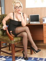 Horny blonde secretary Lana toying with a dildo