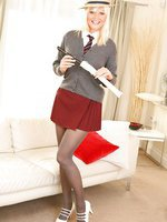 Beauty blonde Sandra seductively removes the college uniform.