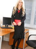 Abbi Taylor wearing secretary suit with black stockings and high heels.
